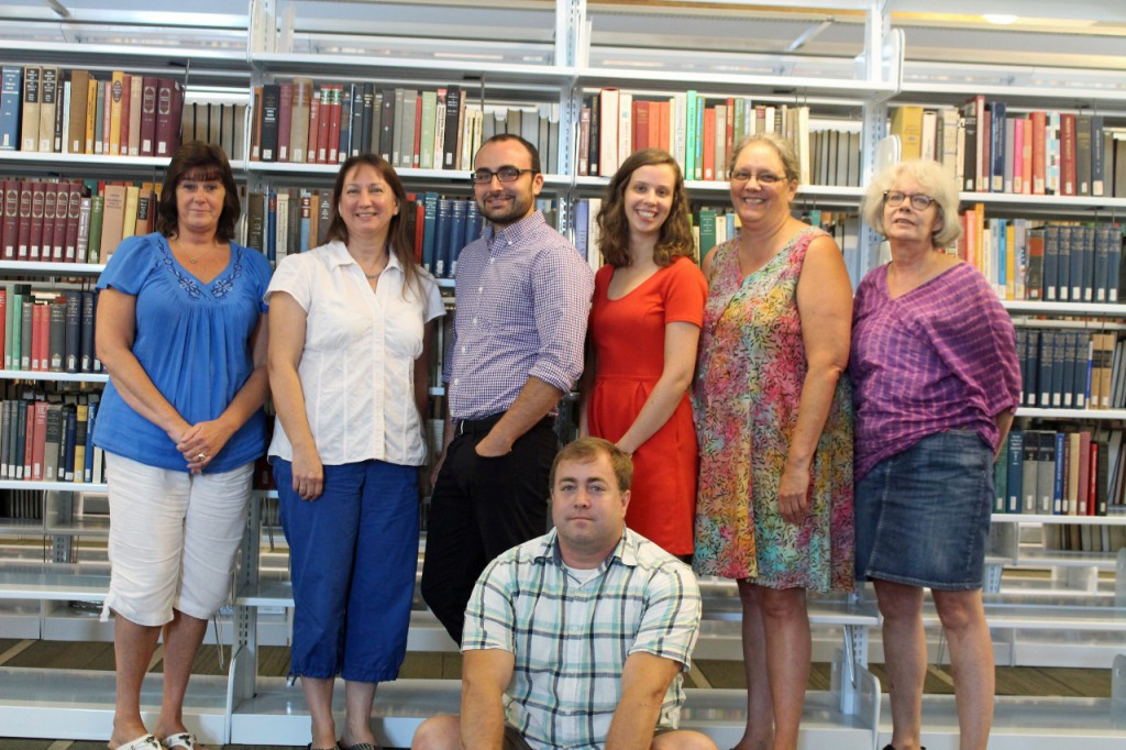 Library staff, left to right (back row): Terry Smith, Judi Ketchum, Tim Dolan, Liza Harrington, Deb Chown, Hope Schneider; front row: Eric Poulin