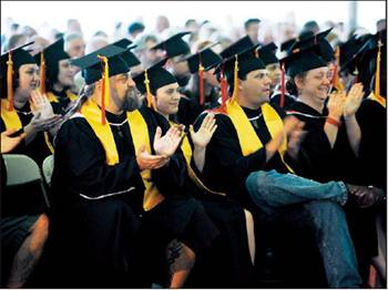 GCC graduates applaud a student's address at commencement Sunday